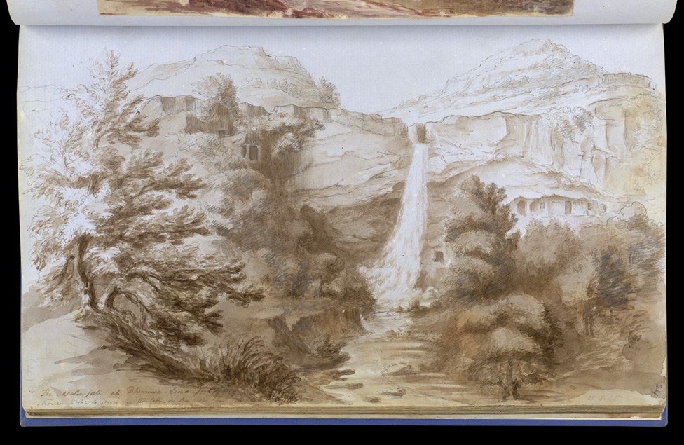 f.24   Panorama of Ellora Caves with waterfall.